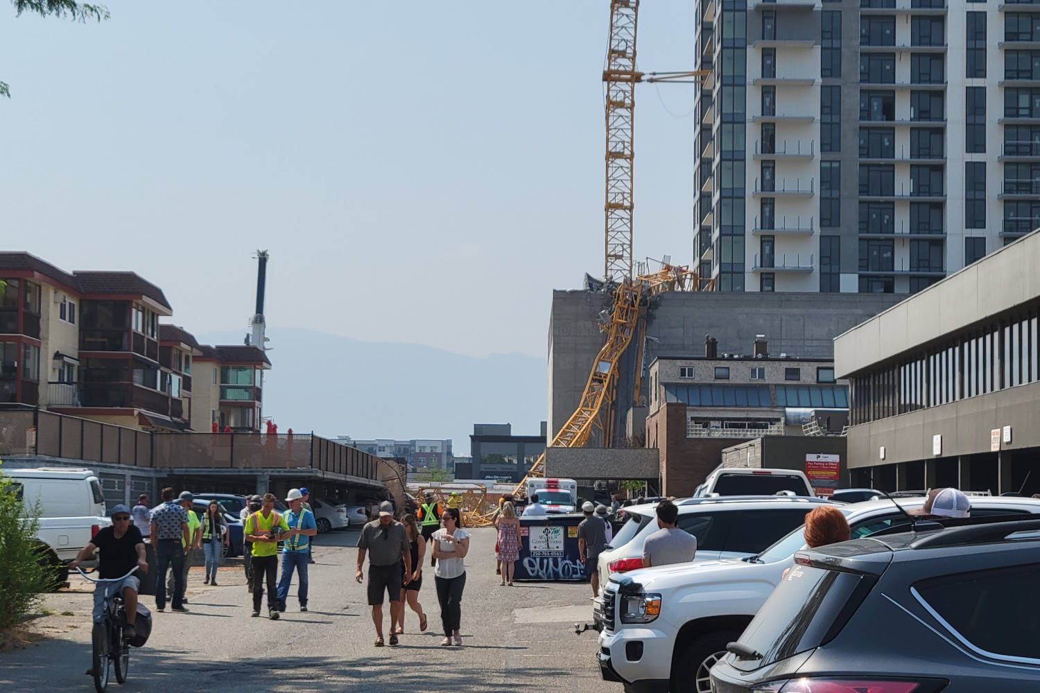 Emergency crews responding to a downtown Kelowna construction site after a crane fell on Monday, July 12. (Michael Rodriguez/Capital News)